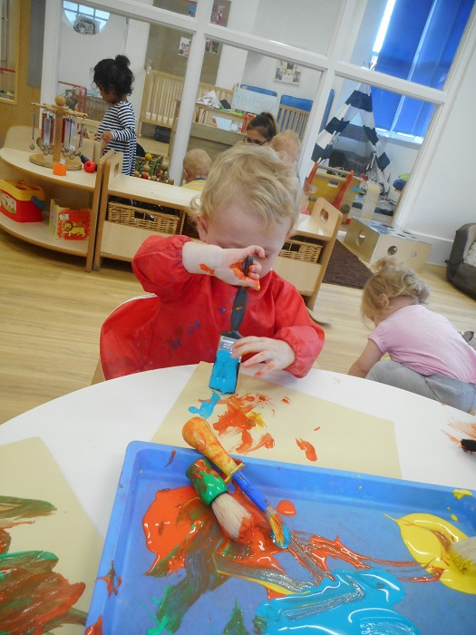 The babies have been exploring the paints, using both paintbrushes and glitter. Children have been developing their fine motor skills by practicing holding the brushes in a palmar grasp or pincer grip.