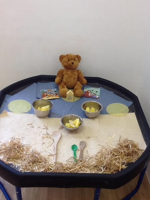 In Preschool 1, Helen set up the tuff spot with some goldilocks and the three bears story props. Helen encouraged the children to access the tuff spot and explore the props.