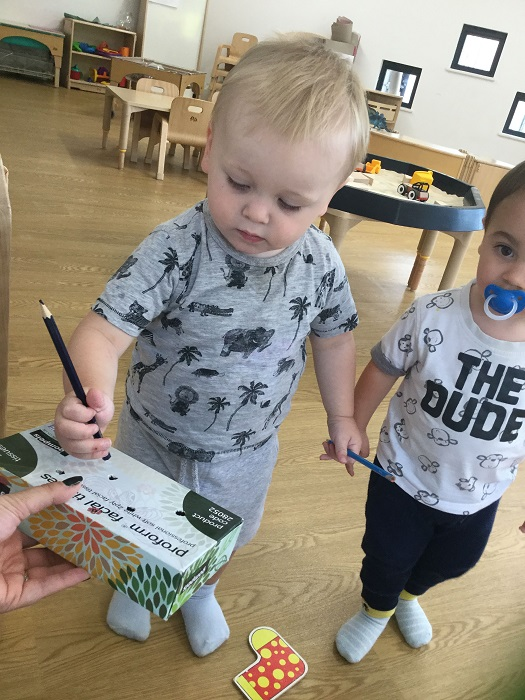 Today in pre-toddlers, we have been posting pencils through the bottom of a tissue box. It may sound like a very simple activity, but it was an excellent way for the children to practice using their concentration and their fine motor skills.