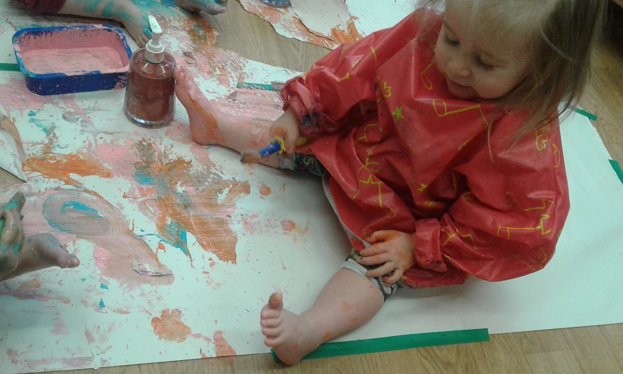 This week in our Pre-toddler room the children have enjoyed exploring different mark making materials on large pieces of paper taped together and placed on the floor.