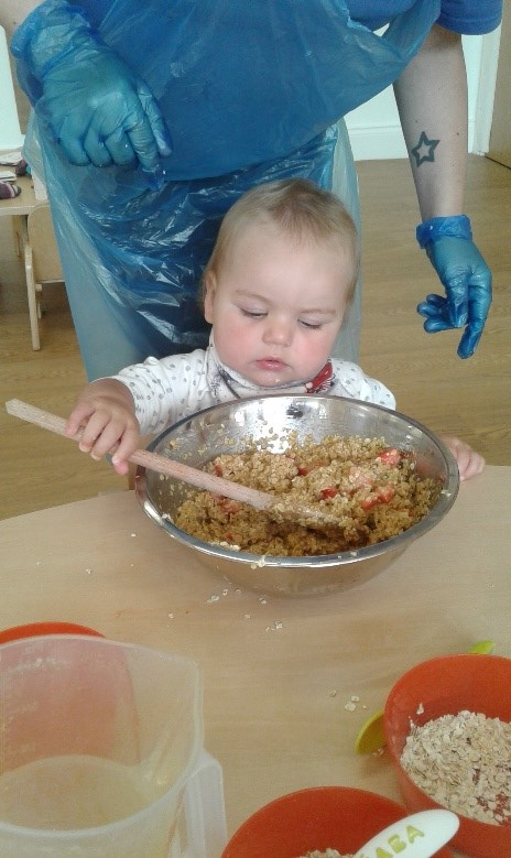 The babies had a fantastic time helping to create strawberry flapjacks