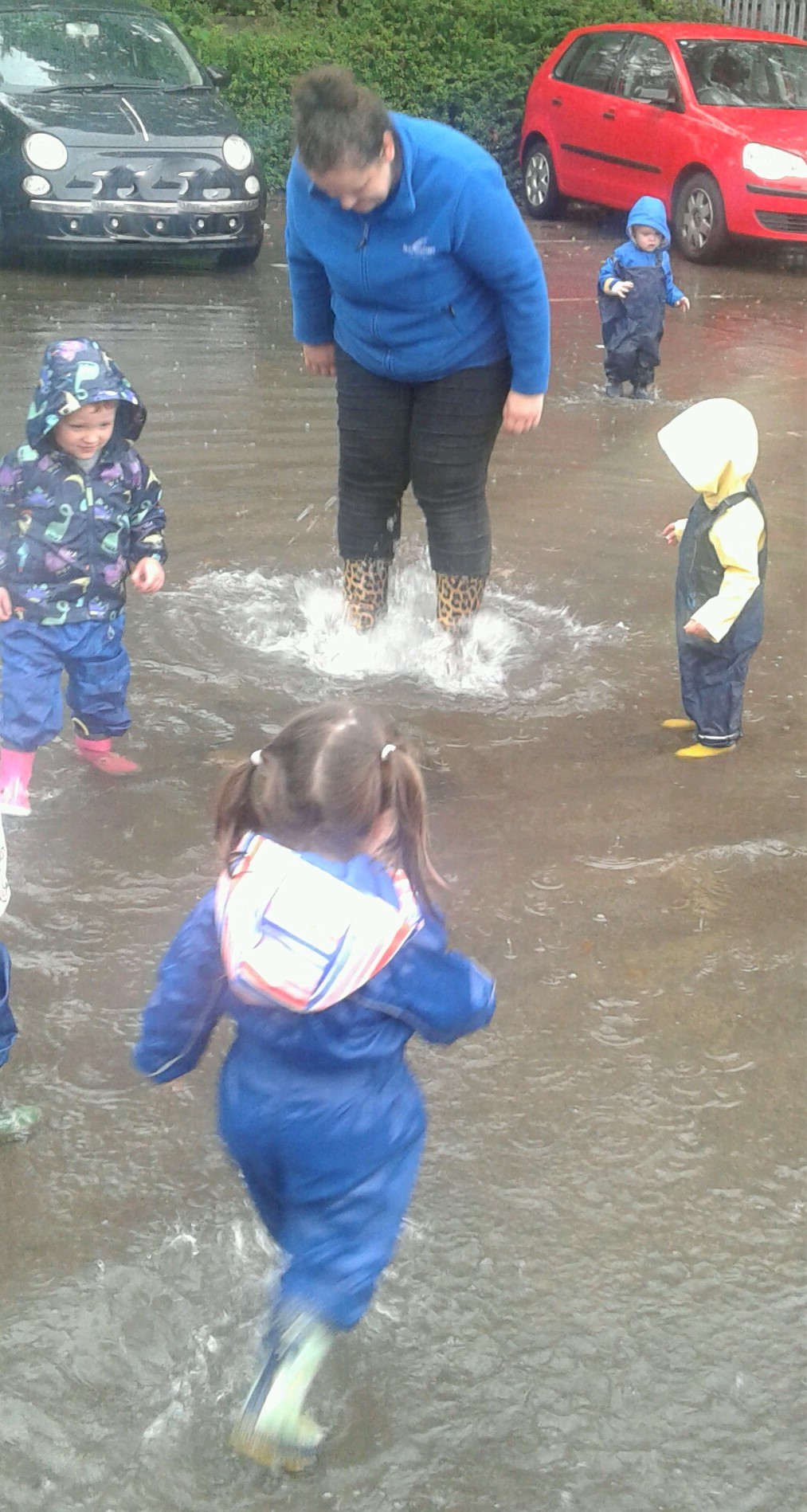 Hinckley toddlers have been making the most of the recent wet weather, putting on their rain suits and wellies to head out and play in the huge puddle we had outside