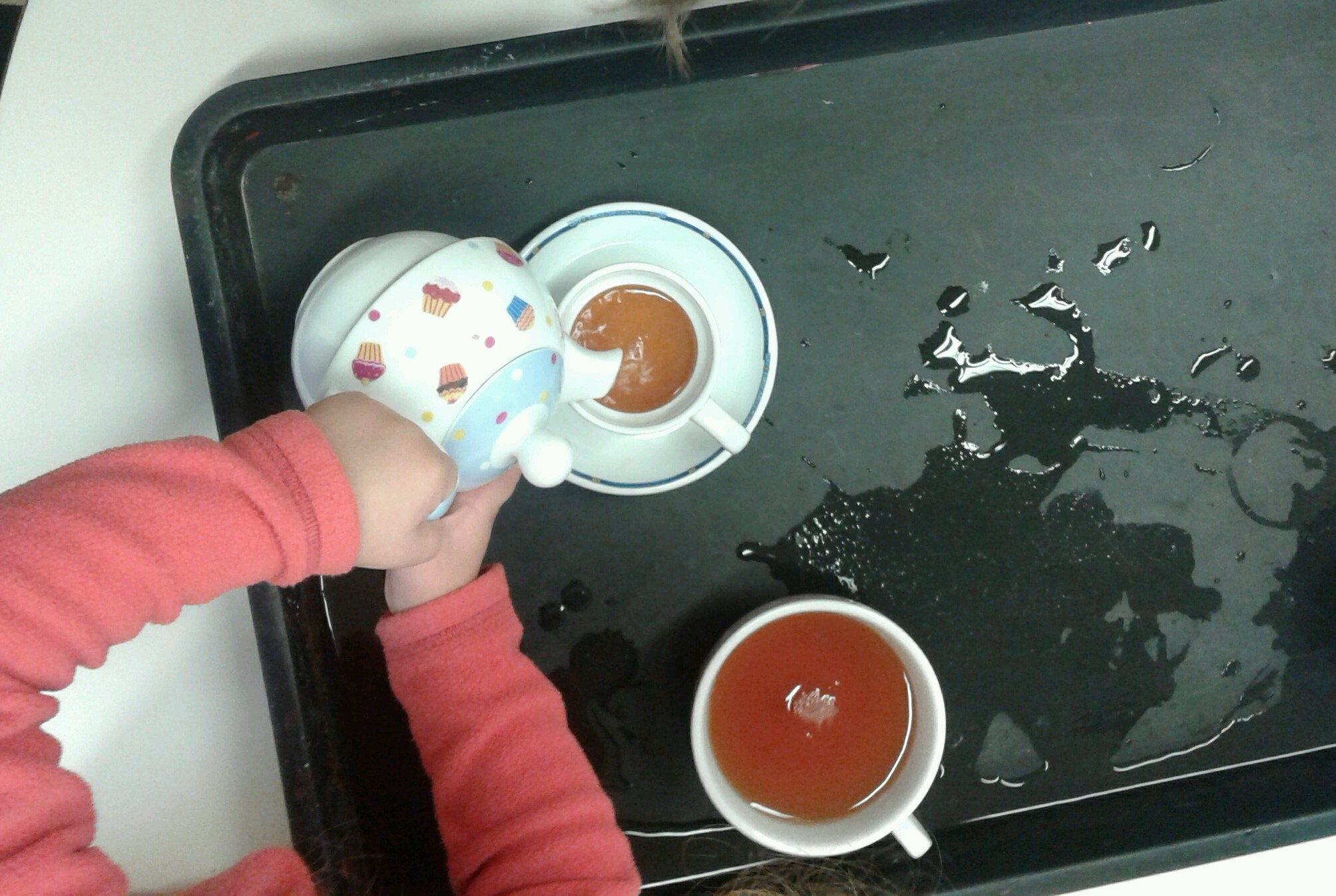 Today Toddler 1 have been making tea using their china tea pots and cups!