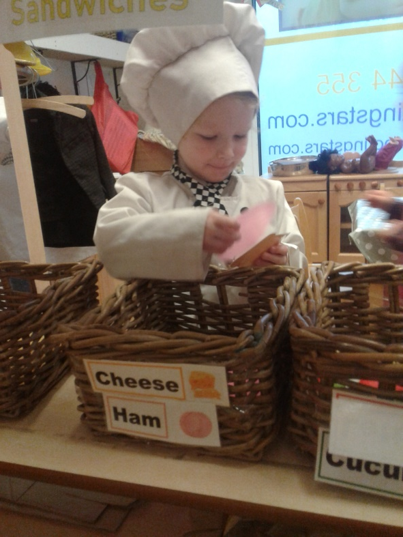 Pre-School 2 have been showing an interest in making and preparing food, so we have turned our role play area into a sandwich shop.