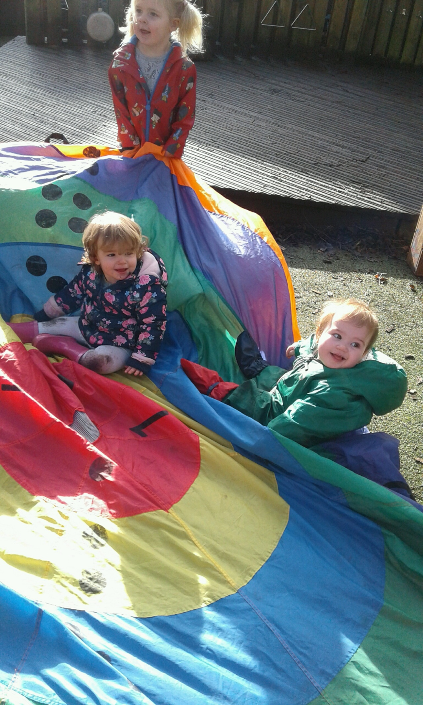 In the baby room we have been focussing on experiencing different physical activities whilst exploring in the garden.