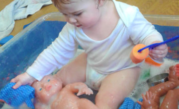 Last week the Baby room enjoyed exploring and splashing around in the water!