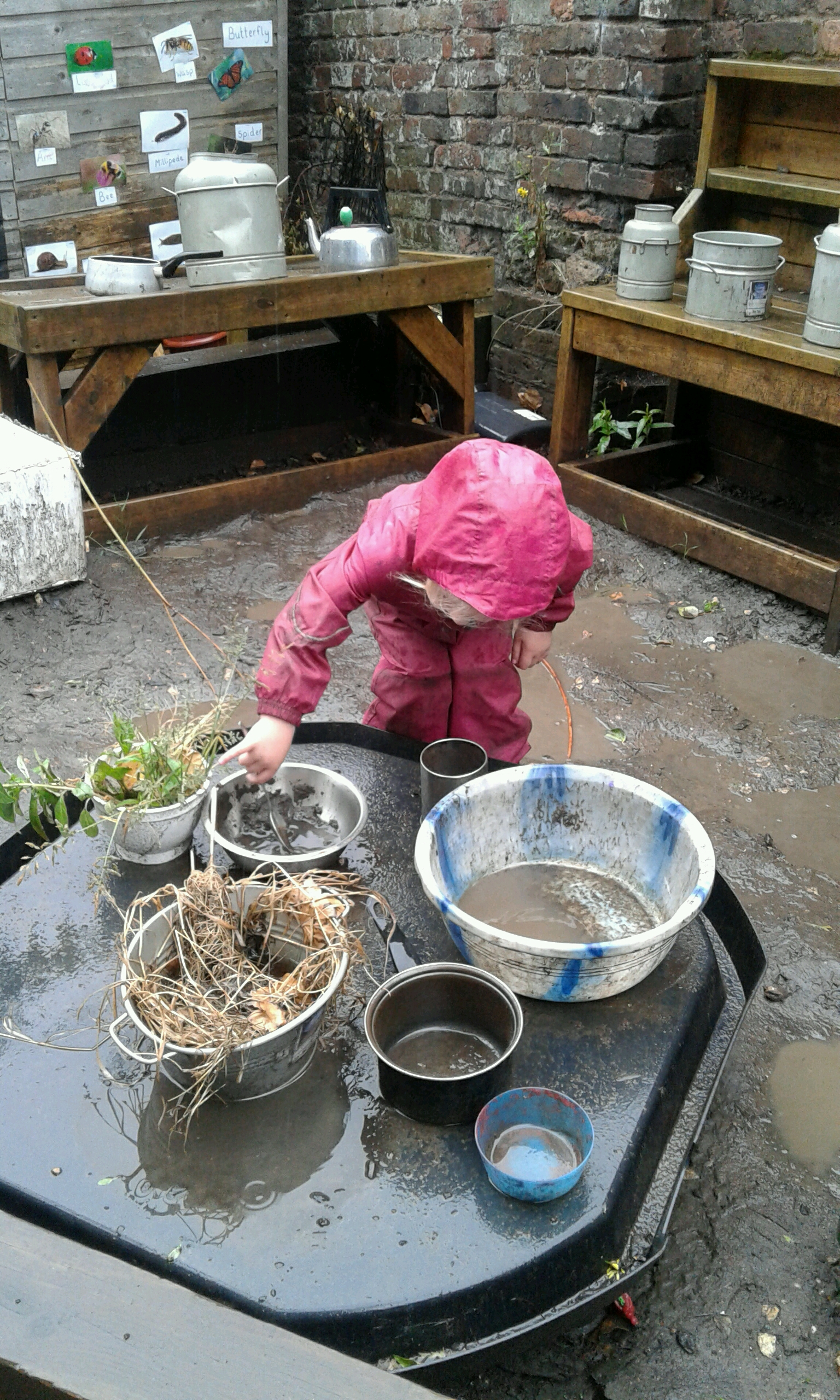 Last week the children had lots of fun in the mud kitchen outside while the rain was pouring!