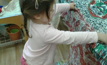 This morning in the toddler room the children helped to make a tent using different materials.