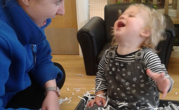 Hinckley – Exploring shredded paper in the baby room