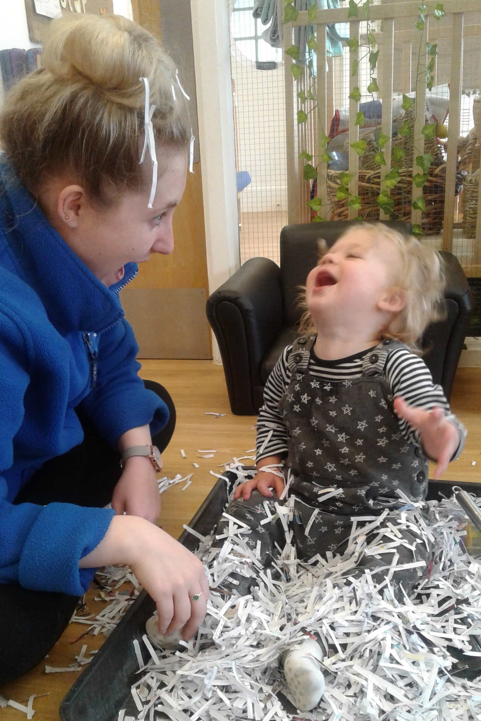 In the baby room, we have had so much fun exploring shredded paper!