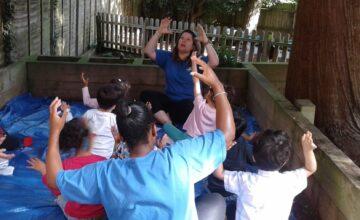 Wolverhampton preschool have been enjoying yoga in the garden under the shade of the big tree