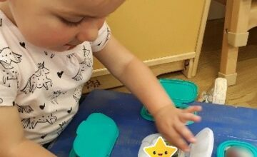 Kings Norton Pre-Toddlers have enjoyed looking at their family photos using the peek-a-boo board.