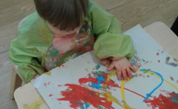 The babies have enjoyed mark making with their hands in wet paint
