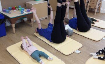 The babies have been enjoying doing yoga - baby room style!