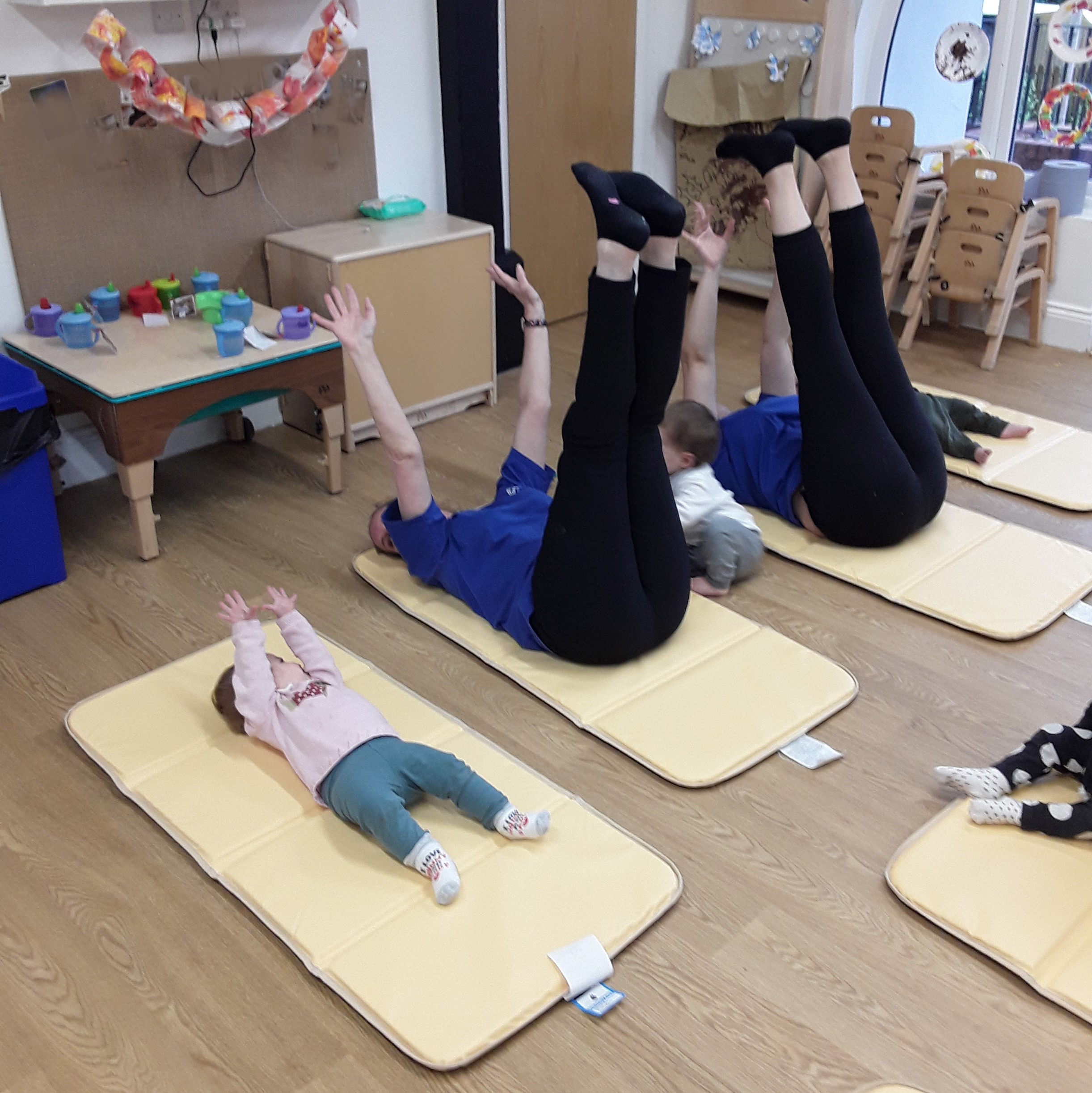 The babies have been enjoying doing yoga - baby room style!