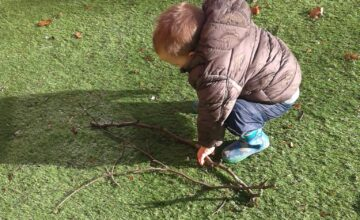 The toddlers enjoyed exploring the garden after a storm